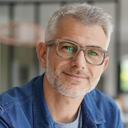 Middle-aged guy with eyeglasses and blue shirt